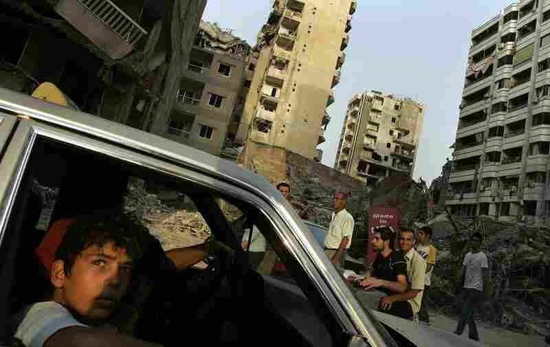 A boy looks out at the destruction in Beirut's southern suburbs, Aug. 21, 2006.