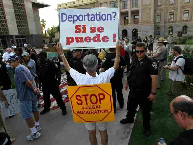 A demonstration against illegal immigration last July in Phoenix brought out hundreds of supporters of SB 1070.