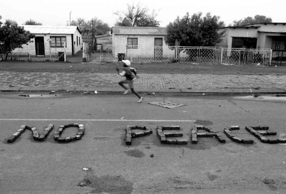 "Greg Marinovich and Joao Silva are members of ""The Bang-Bang Club,"" a group of photographers who covered the civil war in South Africa and the waning days of apartheid. Silva snapped this photo shortly before South Africa's first nonsegregated election in April 1994."