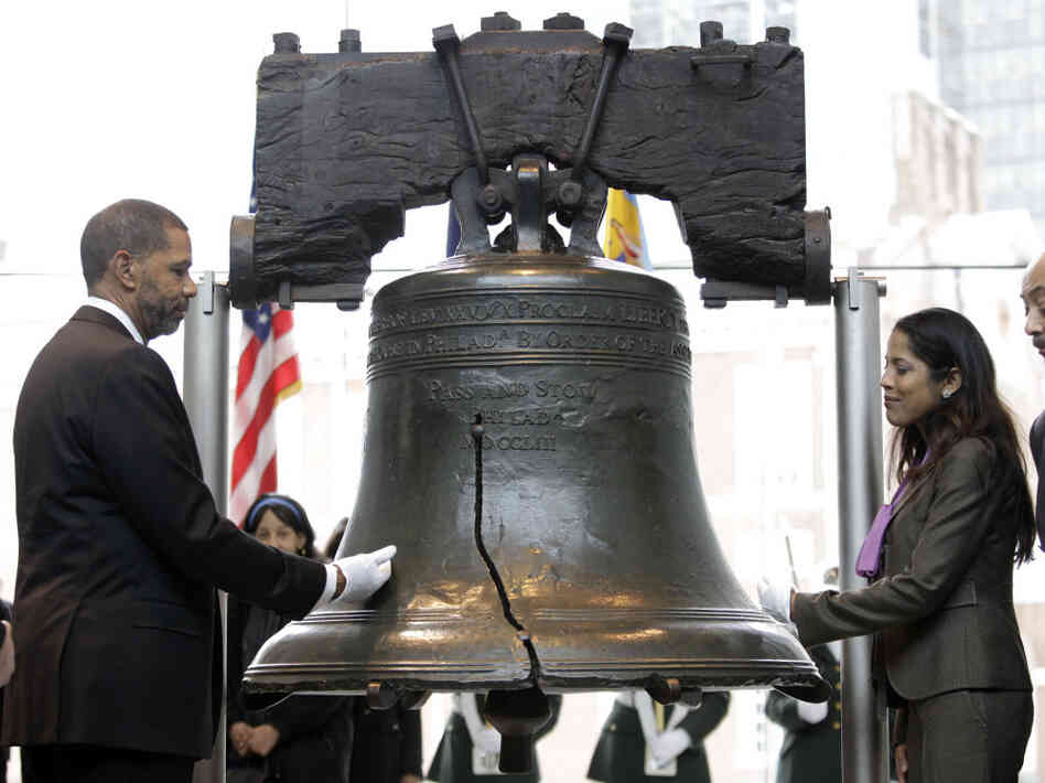 Assistant Secretary for Civil Rights Russlynn Ali and CEO of AmeriHealth Mercy Family Michael Rashid touch the Liberty Bell during a symbolic ringing to mark the observance of Martin Luther King Jr. Day in Philadelphia.
