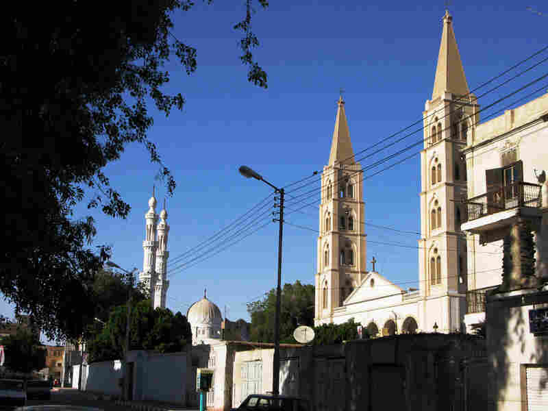 Churches and mosques stand in close proximity in Qena, a town where  Muslims and Christians have lived together for centuries and where tensions are  now running high.