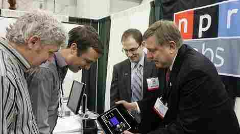Rich Rarey and Mike Eskenazi, of NPR Labs, demonstrate to visitors at their NAB booth.