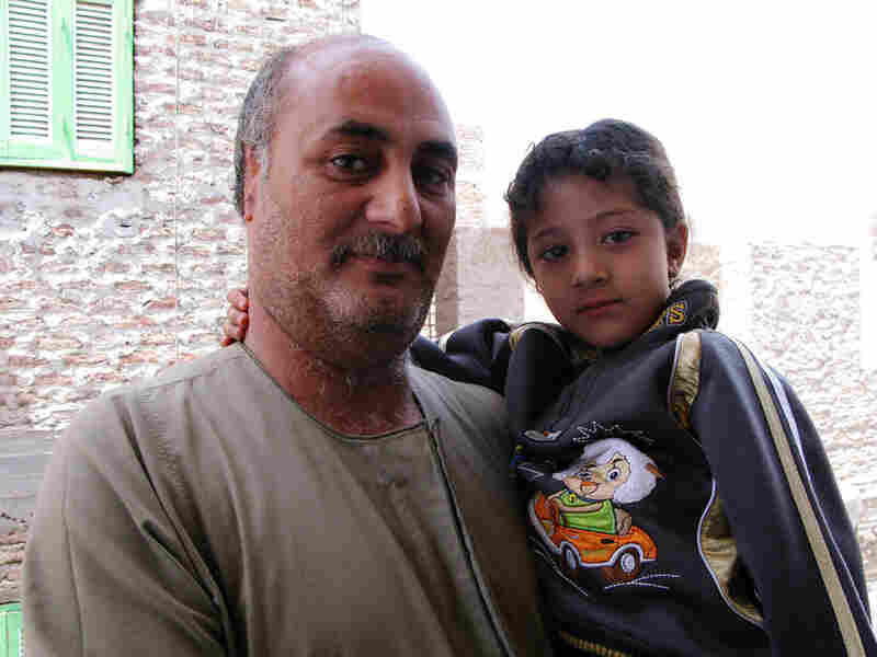 Christian landlord Ayman Dimitry, shown with his 5-year-old daughter, Juliena, says his ear was cut off by men who accused him of renting an apartment to Muslim prostitutes.