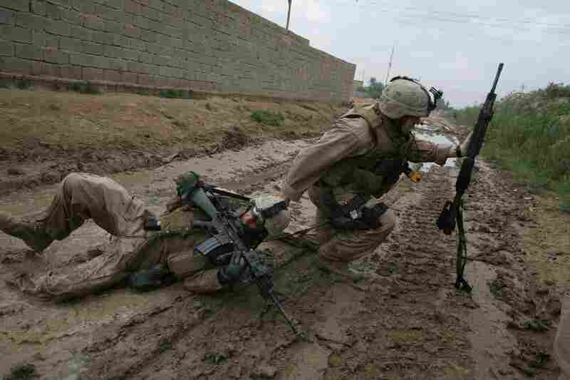 One of Silva's most well-known photographs, taken in Iraq, shows Sgt. Jesse E. Leach dragging Lance Cpl. Juan Valdez to safety moments after Valdez was shot by a sniper during a joint patrol with the Iraqi army in Karmah, Anbar province. Valdez survived.
