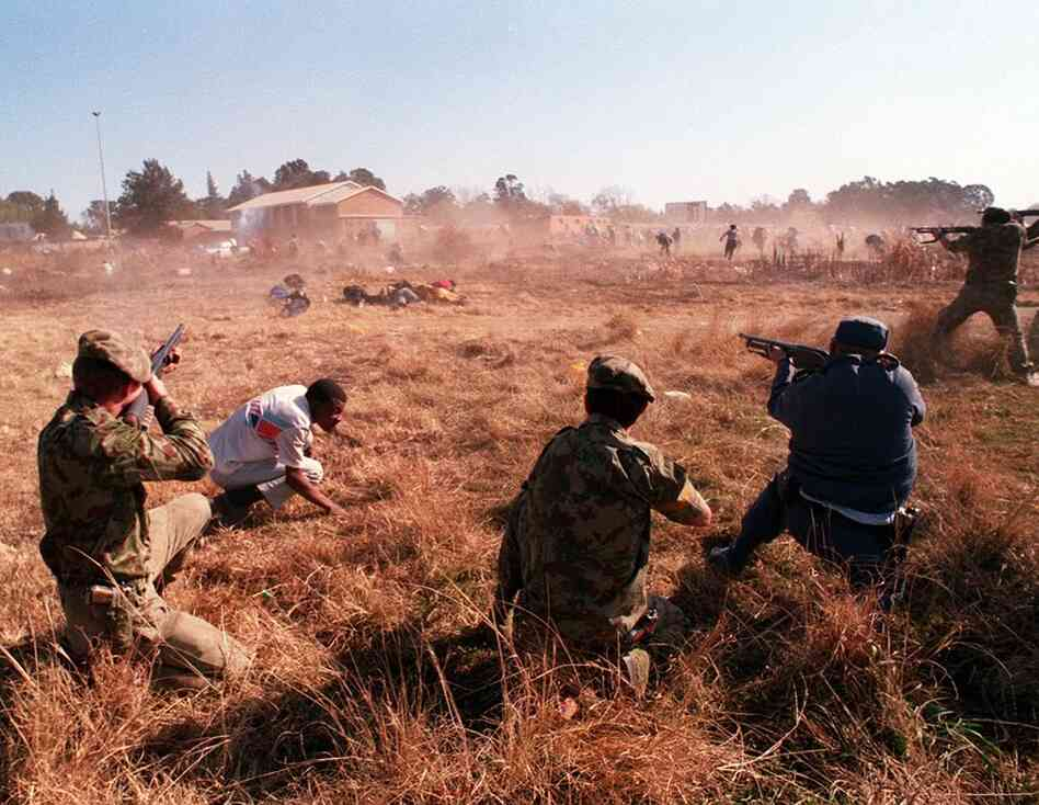 Marinovich was shot three times while covering battles in South Africa. Here, he documented policemen who opened fire on an unarmed crowd of Boipatong residents days after a massacre in 1992.
