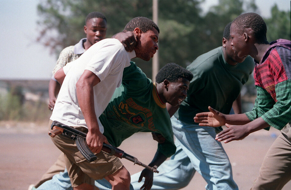 A week before South Africa's elections in 1994, clashes broke out in the eastern suburbs of Johannesburg between the Zulu Inkatha Freedom Party and African National Congress supporters. Armed residents frequently had to scramble for cover.  (AP)