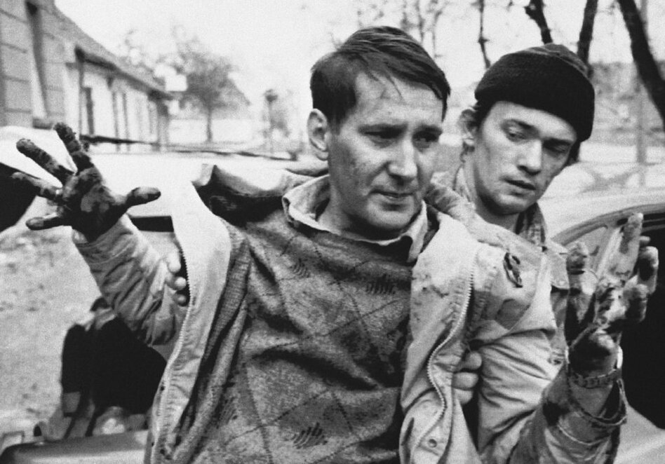 Marinovich traveled to the Balkans in 1991 to document the Yugoslavian conflict. Here, he captured a wounded civilian who was helped to a car by a passerby during an artillery attack in Croatia on Nov. 30, 1991.  (AP)
