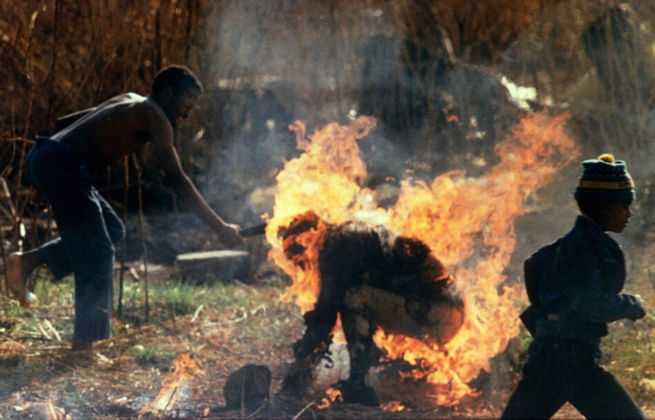 Marinovich won the Pulitzer Prize for Spot News Photography in 1991 for a series of photos showing an unarmed man identified as a Zulu Inkatha supporter being burned and clubbed to death by African National Congress supporters in September 1990.  (AP)