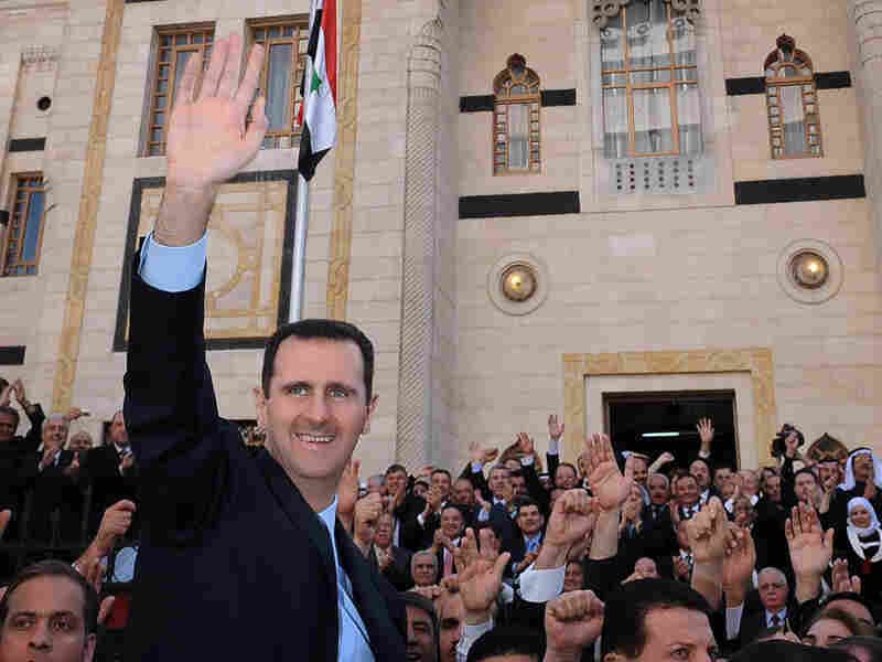 Syrian  President Bashar al-Assad waves to supporters after making a speech to  Parliament in Damascus on March 30.