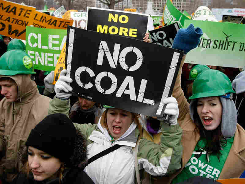 Activists hold signs as they participate in the Power Shift '09 rally in Washington, D.C., to call for urgent congressional actions on climate change, energy and the economy.