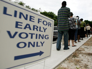 People wait in line at the Boynton Beach Civic Center in Palm Beach County, Fla., for early voting, on Oct. 22, 2008. That year, early voting helped Barack Obama carry the state. Now, Republicans want to shorten the number of days Floridians can vote early.