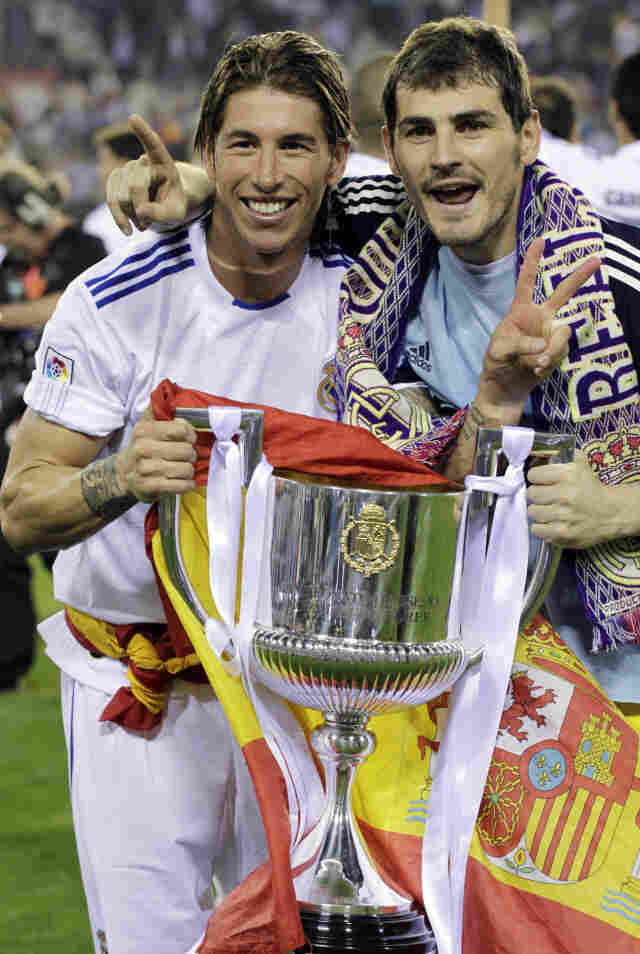 Real Madrid's Sergio Ramos, left, had a better grip (and help from teammate Iker Casillas) on the trophy earlier in the evening Wednesday.