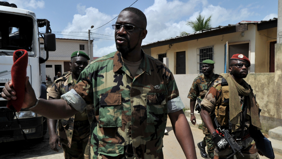 Ibrahim Coulibaly walks in the Abobo neighborhood of Abidjan on Tuesday. Coulibaly says he's the head of a militia called the Invisible Commando. The group fought against former President Laurent Gbagbo's forces, but has not joined the newly renamed army, the Republican Forces of Ivory Coast.