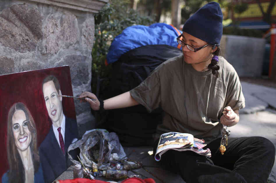 Estibalis Chavez paints a portrait of Britain's Prince William and Kate Middleton in front of the British Embassy in Mexico City.