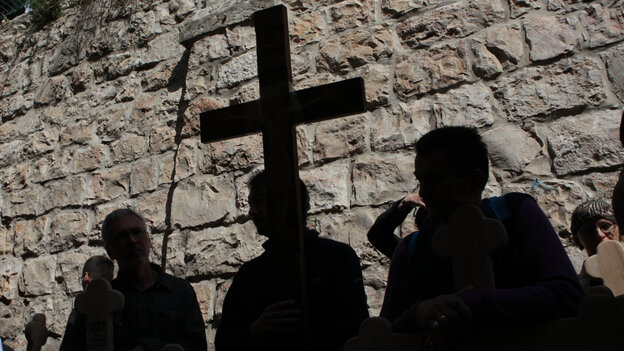 Christian pilgrims carried wooden crosses along the Via Dolorosa during the Good Friday procession in Jerusalem's old city today (April 22, 2011).