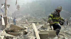 Sept. 11, 2001: A firefighter walks through the rubble at New York's World Trade Ce