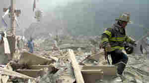 Sept. 11, 2001: A firefighter walks through the rubble at New York's World Trade Center.
