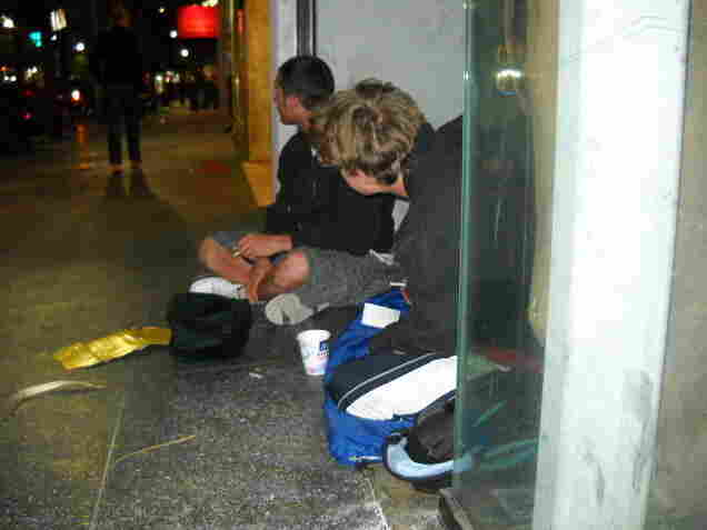 Two teens sit in an empty storefront on Hollywood Boulevard. Covenant House workers say teens often come to Hollywood with hopes of breaking into show business, however, a different fate awaits them.