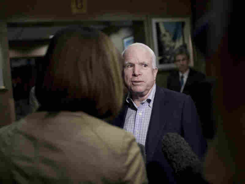 Sen. John McCain talks with journalists Friday at the Tebisty Hotel in Benghazi, Libya. McCain, who has been one of the strongest proponents in Congress of U.S. military intervention in Libya, says he plans to meet with the rebel National Transition Council, the de-facto government in the eastern half of the country, and members of the rebel military.