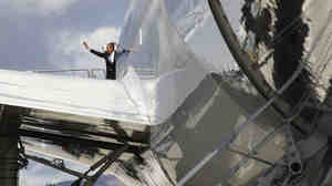 President Barack Obama waves from Air Force One before taking off from Reno, Nev., Thursday.