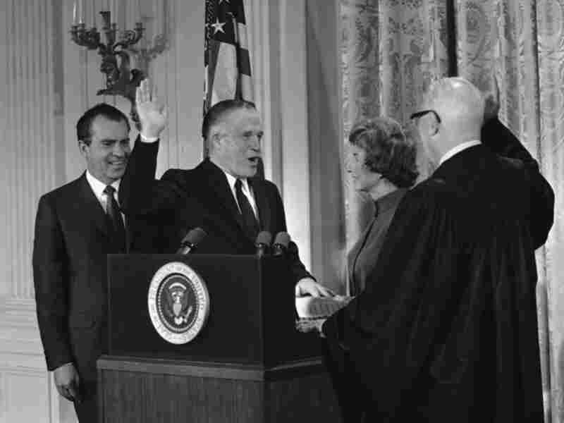 George Romney is sworn in as  secretary of Housing and Urban Development in 1969 at the White House. The oath was administered by Chief Justice Earl Warren and attended by Romney's wife and President Nixon.
