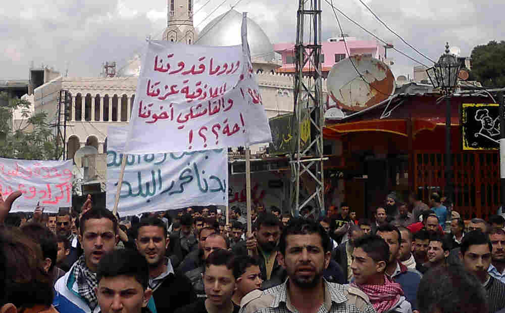 A cellphone picture purportedly shows Syrian anti-government protesters taking part in a demonstration in the northeastern city of Banias on Friday.