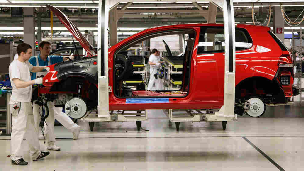 Workers assemble Volkswagen Golf 6 cars at the Volkswagen factory in Wolfsburg, Germany. Volkswagen and other German automakers are among those driving Germany's economic boom.
