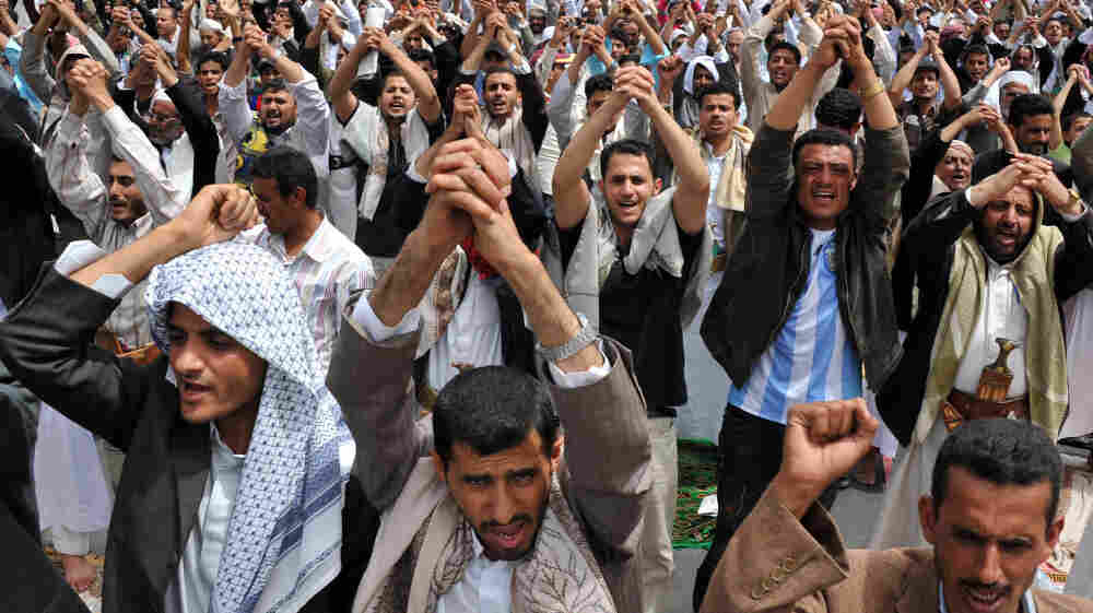 Tens of thousands of protesters chant slogans during a demonstration calling for the ouster of Yemeni President Ali Abdullah Saleh, following Muslim Friday prayers in Sanaa on Friday.