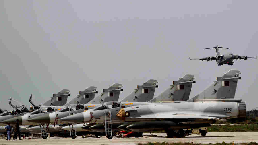 Qatari Air Force Mirage 2000 jet fighters prepare to takeoff for a mission to Libya at the  military airbase base of Souda on the Greek island of Crete on March 30.