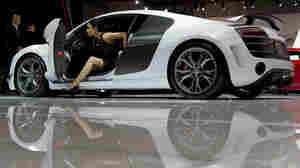 A model climbs out of an Audi during the New York International Auto Show.