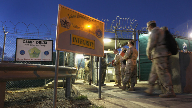 U.S. military guards arrive for their sunrise shift at Camp Delta at the U.S. detention center in Guantanamo Bay, Cuba. (Getty Images)