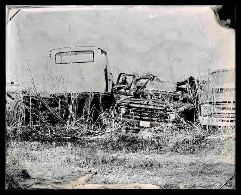 Photographer Tod Seelie in a scrapyard in La Grange, Texas