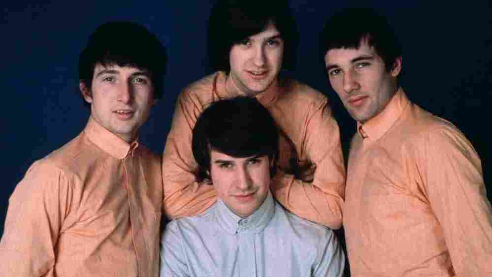 The Kinks, from left to right clockwise: Pete Quaife, Dave Davies, Mick Avory and Ray Davies, front and center.