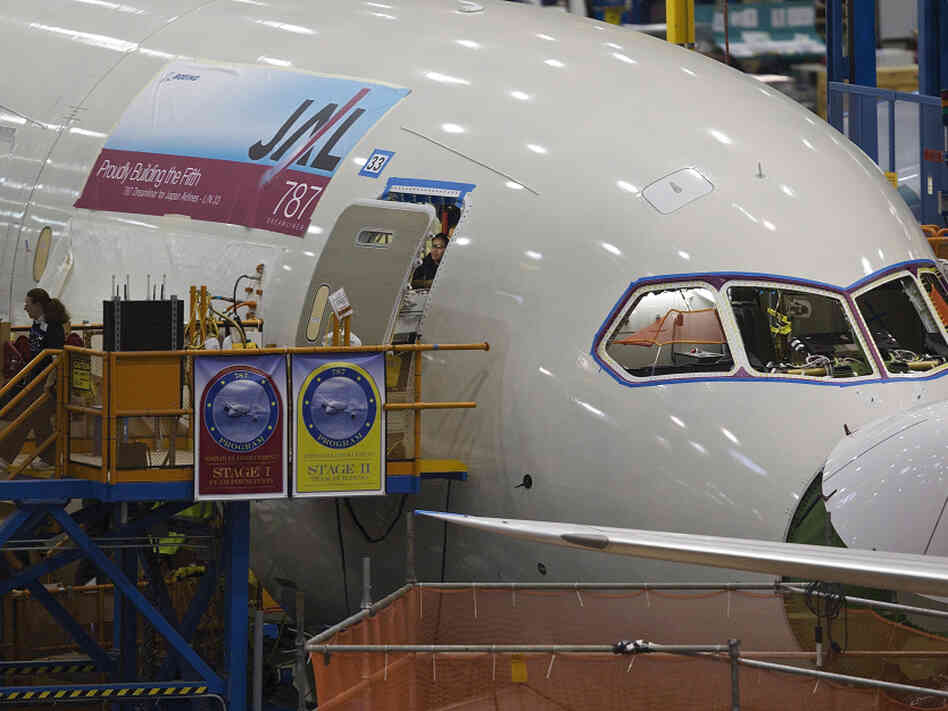 Boeing employees work on a Boeing 787 Dreamliner. The company has been at the center of a dispute with the National Labor Relations Board over where production of the aircraft takes place.