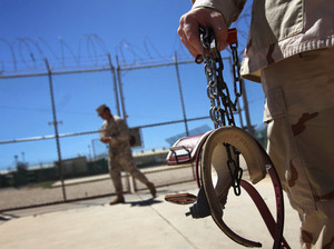 A U.S. military guard carries shackles in preparation for moving a detainee at the U.S. detention center in Guantanamo Bay, Cuba.