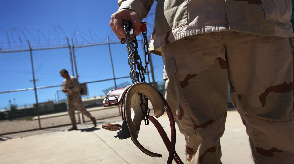 A U.S. military guard carries shackles in preparation for moving a detainee at the U.S. detention center in Guantanamo Bay, Cuba. (Getty Images)