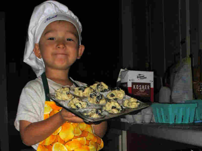 Noah holds an oven-ready pan of Big-Top Blueberry Muffin batter (recipe below).