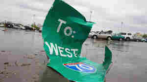 On Saturday, after the tornado, this highway sign sat in a parking lot at Lambert-St. Louis International Airport.