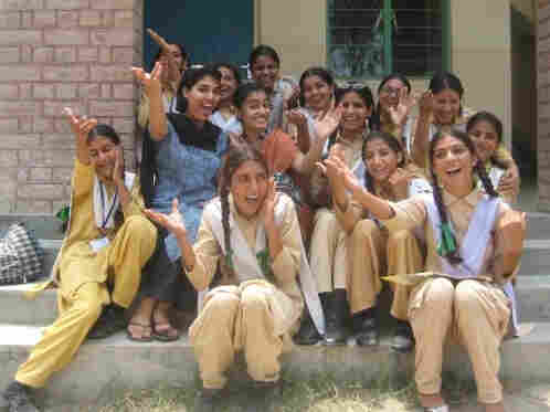 Nadia Naviwala  and her students sing on the steps of an NGO-built school in Minhala,  Pakistan.