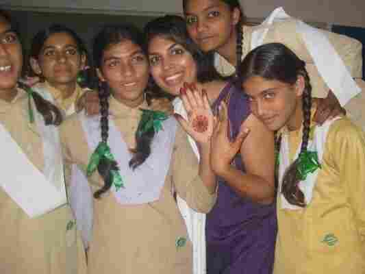 Nadia Naviwala poses with students on the last day of English summer camp at an NGO-built girls' school in a village  on the Pakistan-India border.