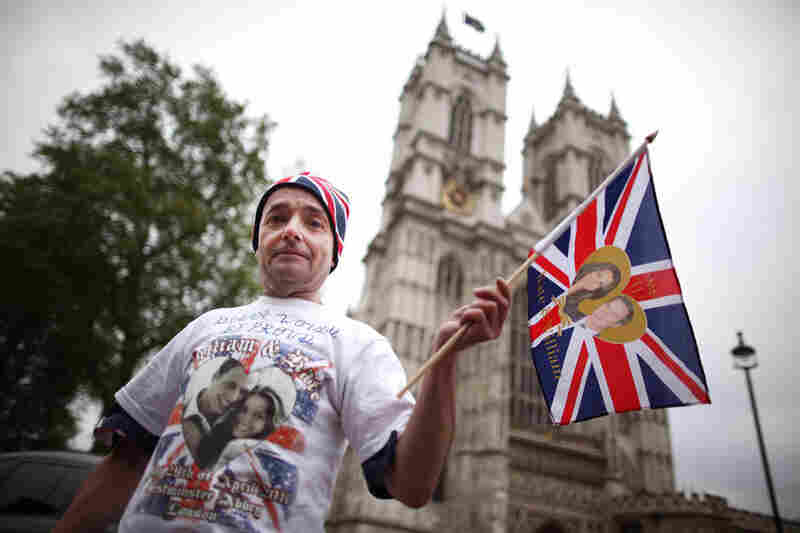 Royal fan John Loughrey camps out on the streets outside Westminster Abbey Tuesday, in anticipation of England's royal wedding.