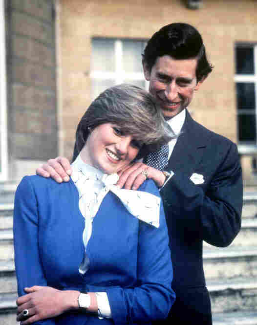 Prince William proposed to Middleton with his mother's blue-sapphire and diamond engagement ring. Here, Britain's Prince Charles and Lady Diana Spencer pose following the announcement of their engagement in February 1981.