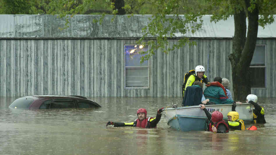 Emergency workers pulled residents of the Oak Glen Residential Community in Johnson, Ark., to safety after a nearby creek flooded its banks.