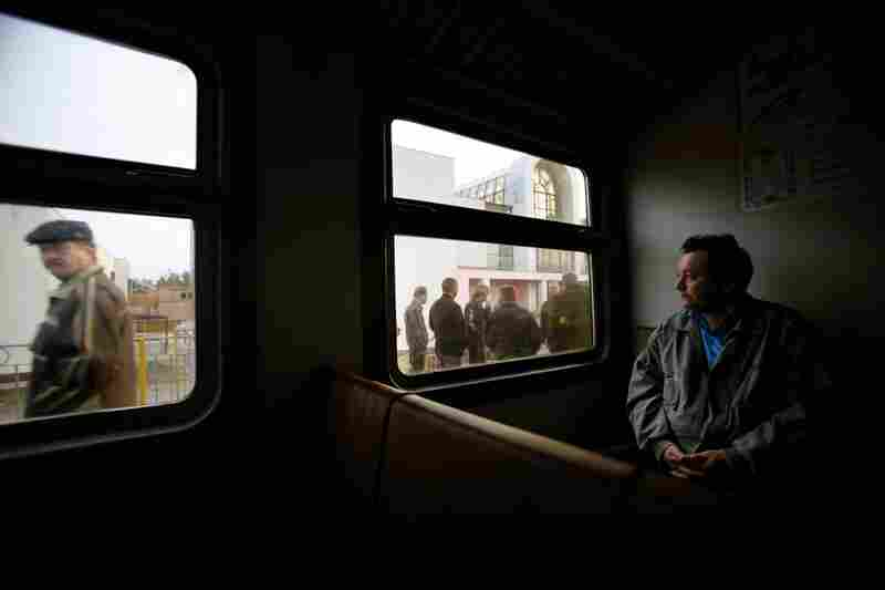 The Chernobyl power plant is still operational. Here, a worker waits on a train in Slavutich, Ukraine, on his way to the plant in 2006. After the 1986 accident, about 50,000 residents of the nearby city of Pripyat were evacuated. Slavutich, located about 37 miles from the plant, was built to house displaced workers and their families.