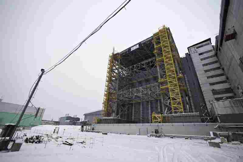 The No. 4 reactor is now encased in a sarcophagus designed to keep radioactive material isolated. The government of Ukraine is trying to raise funds for the construction of a huge new building that will cover the aging sarcophagus.