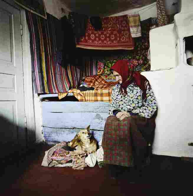 Zinayida Trofimivna Huzienko, 93, talks to her dog inside her home in the village of Ilintsi in 2006. She lives illegally inside the exclusion zone around Chernobyl. Scientists say the area around the plant will not be safe for human habitation for up to 900 years.