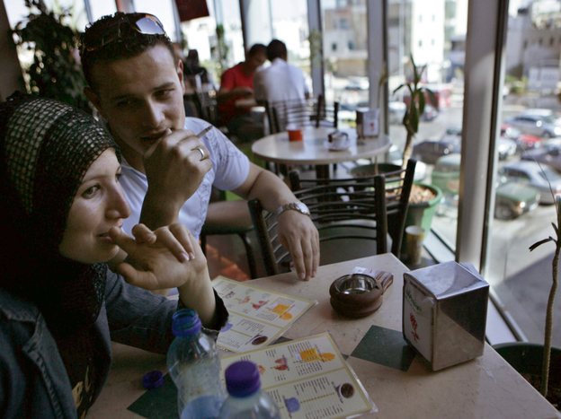 Nidaa Al-Barghothy (left) and her brother  Mohammad Al-Barghothy  sit at a coffee shop in Ramallah, the political and commercial capital of the West Bank, in 2007.