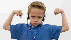 Little boy flexing while he listens to music.