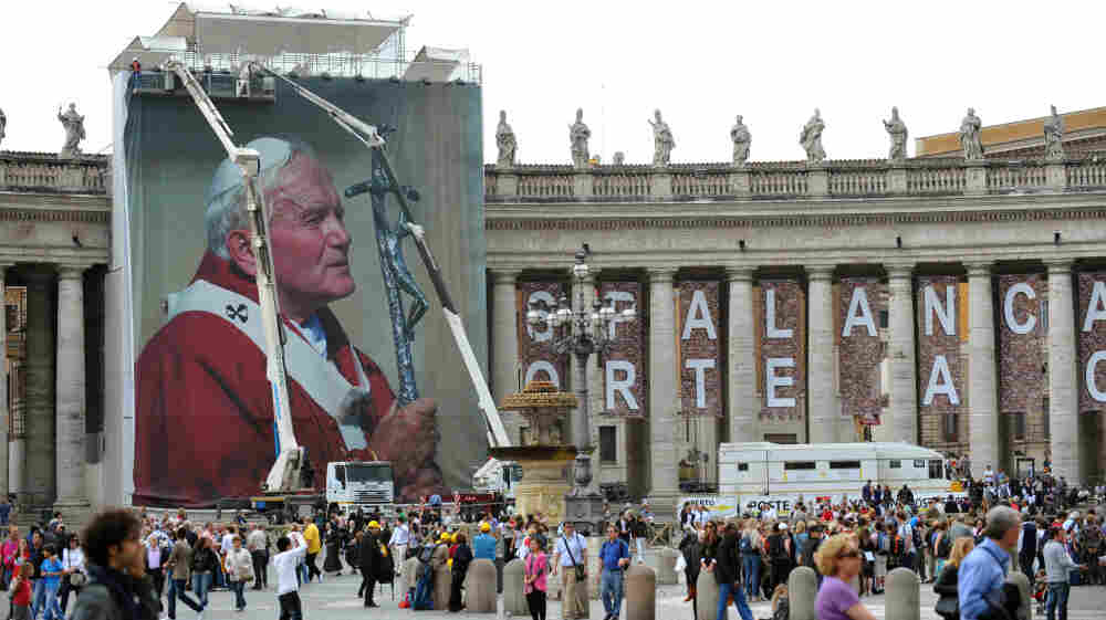 Workers set up a giant photo of the late Pope John Paul II at St. Peter's Square on April 27 at the Vatican. John Paul II will be honored May 1 at a beatification ceremony.