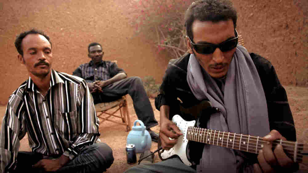 Bombino (right, with guitar) is a rising star in a generation of rebellious Tuareg rockers.